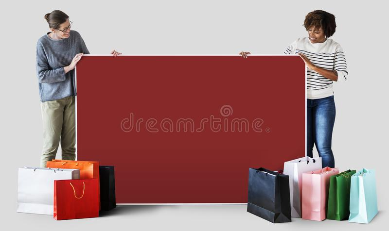 Woman holding a placard and shopping bag stock image