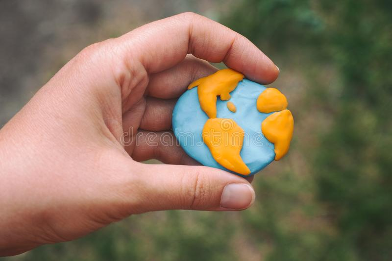 Woman holding planet Earth in her hand stock photo