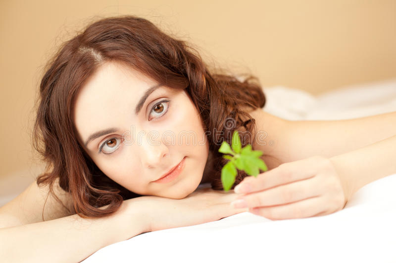 Woman holding a plant (focus on woman