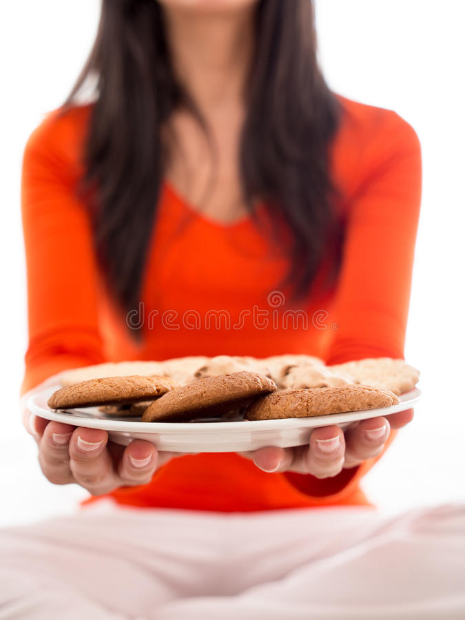 Download Woman Holding Plate Of Biscuits Royalty Free Stock Photography - Image: 27519757