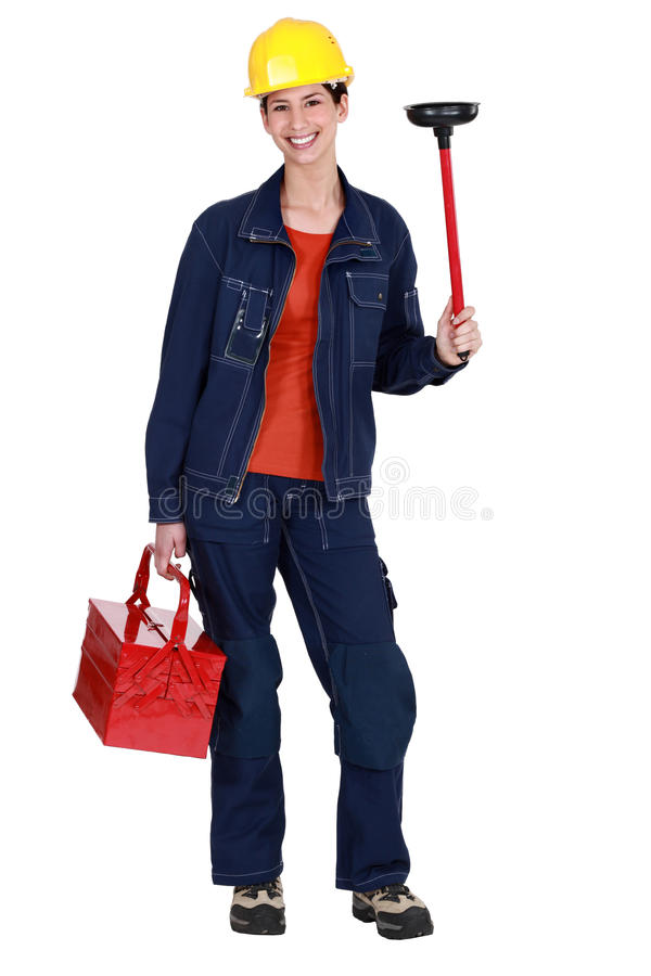 Woman holding plunger. And tool box royalty free stock photography
