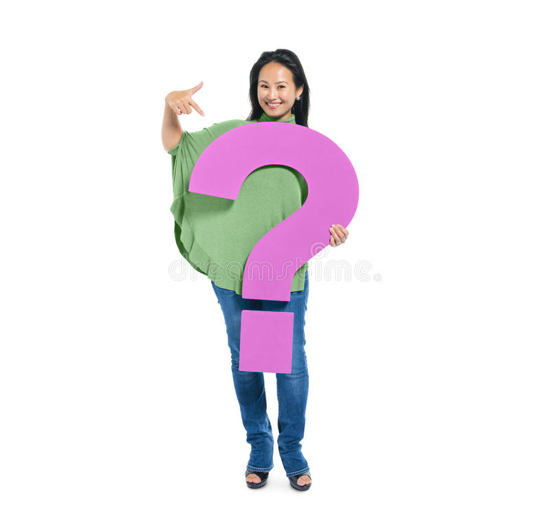 Woman Holding and Pointing Question Mark royalty free stock images