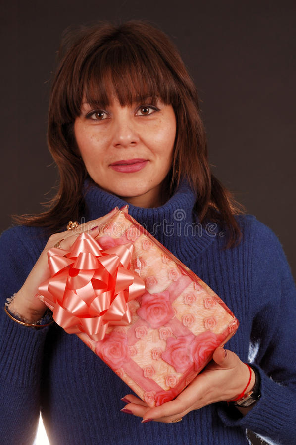 Woman holding present royalty free stock images