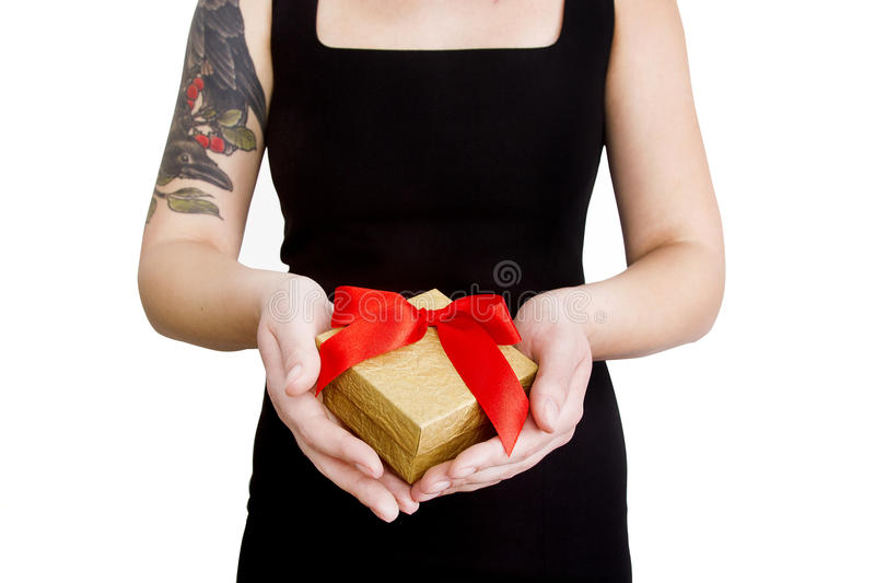 Woman holding present.Hands with tattoo. royalty free stock photography