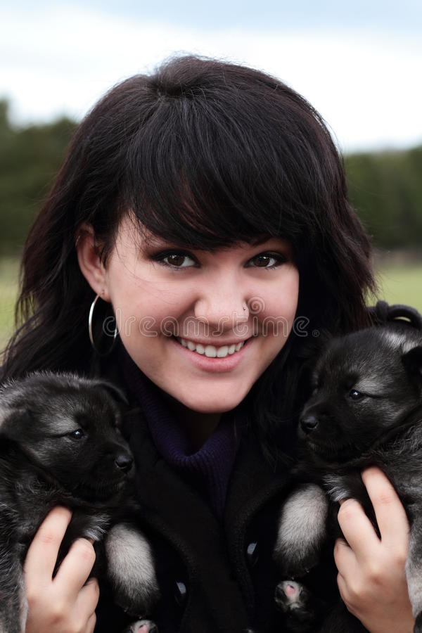 Download Woman Holding Puppies stock photo. Image of looking, girl - 17246342