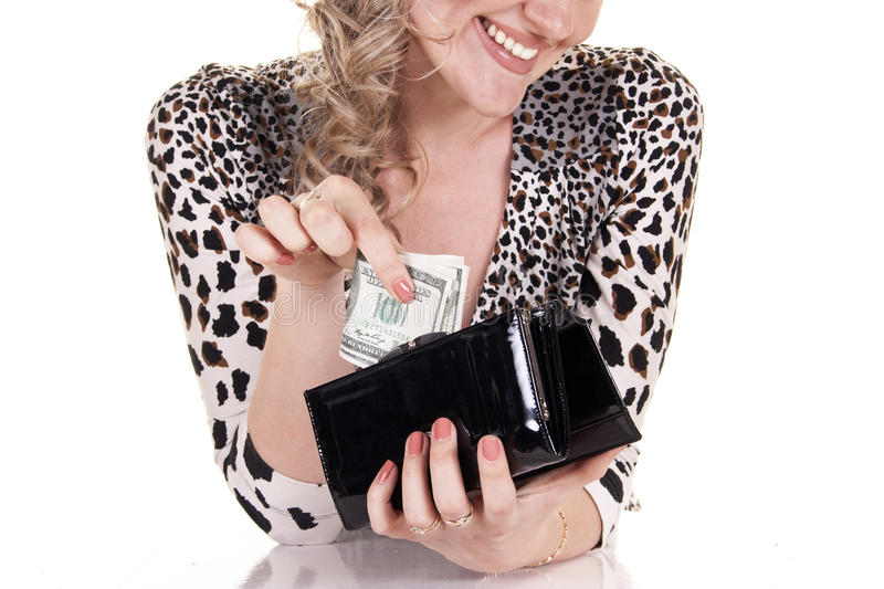 Woman holding purse with cash