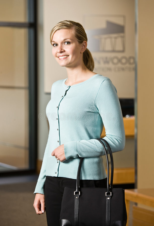 Download Woman Holding Purse In Office Lobby Stock Photo - Image: 6603946