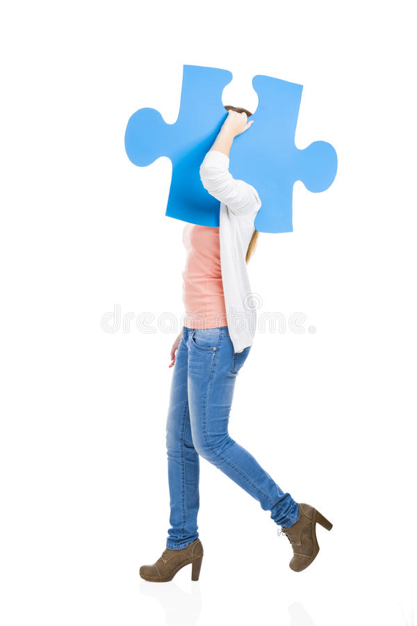 Woman holding a puzzle stock images