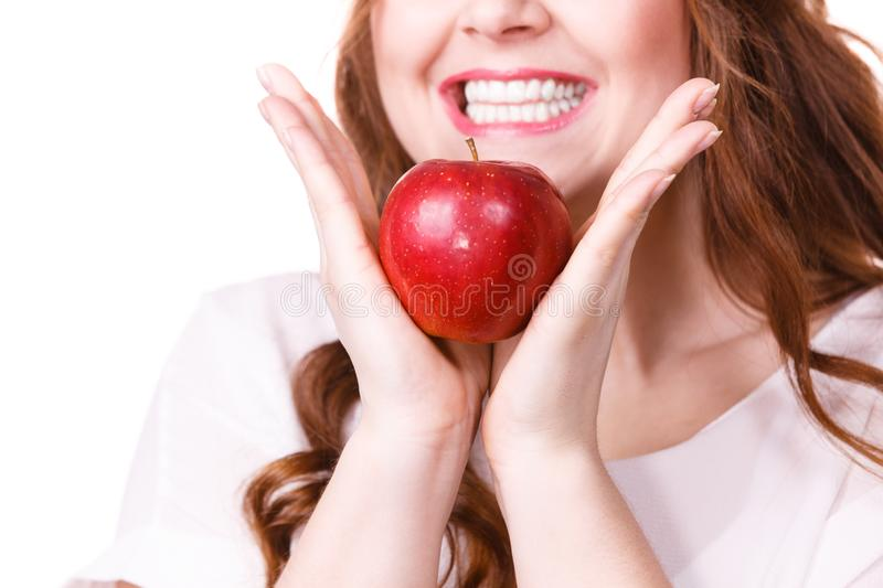 Woman holds apple fruit close to face, isolated royalty free stock photo