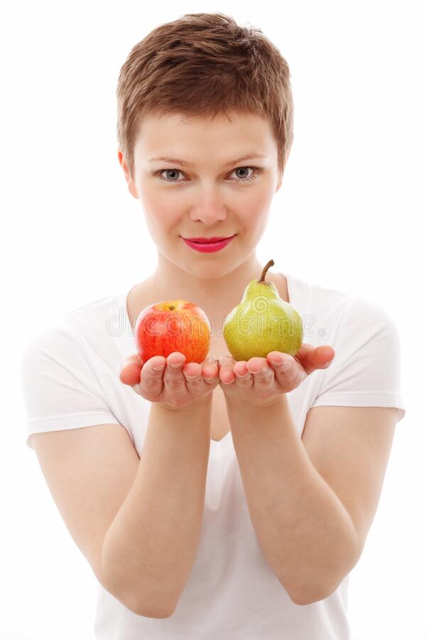 Woman Holding Red Apple and Green Peach stock photos