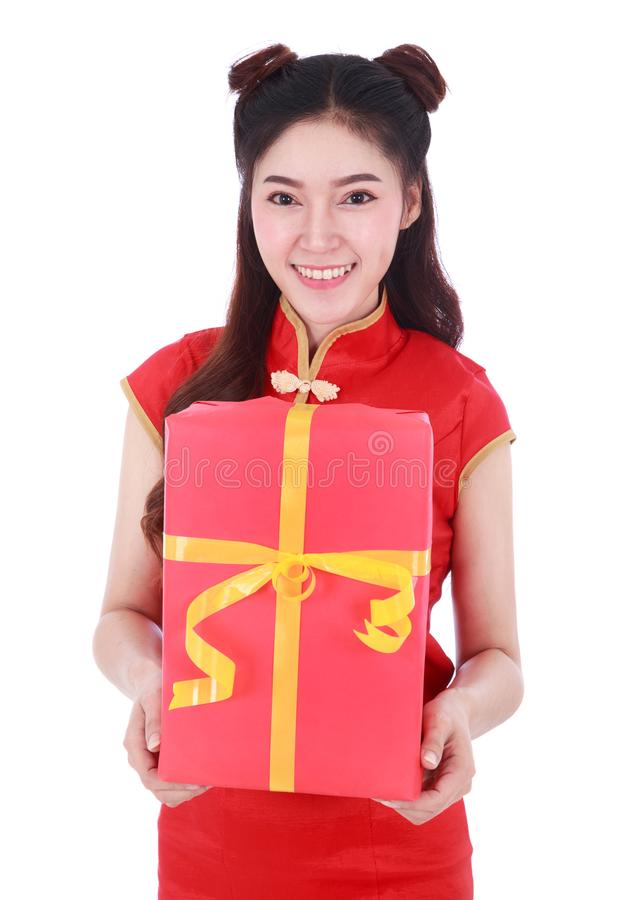 Woman holding red gift box in concept of happy chinese new year royalty free stock image