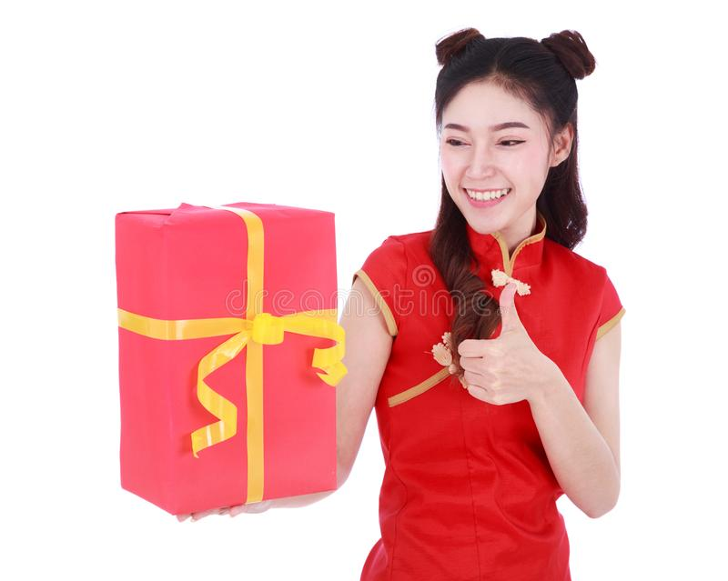 Woman holding red gift box in concept of happy chinese new year stock photos