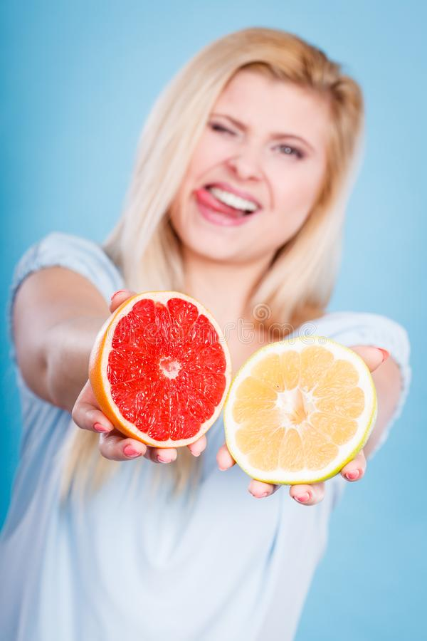 Woman holding red and green grapefruit royalty free stock image