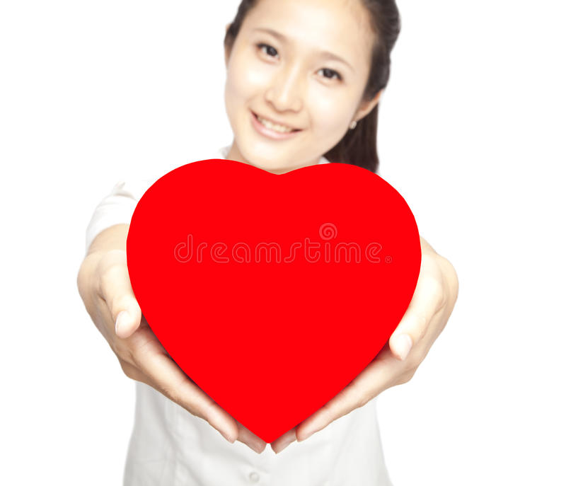 Download Woman holding red heart stock photo. Image of positive - 22957764