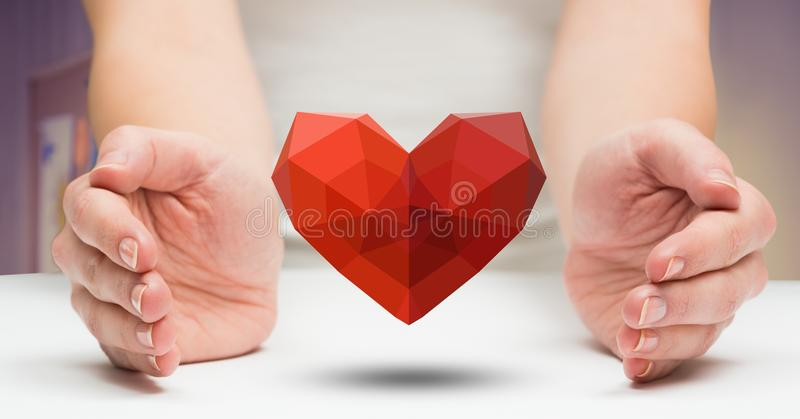 Woman holding red heart stock image