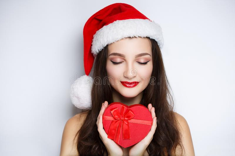Woman holding red heart, santa with present royalty free stock images