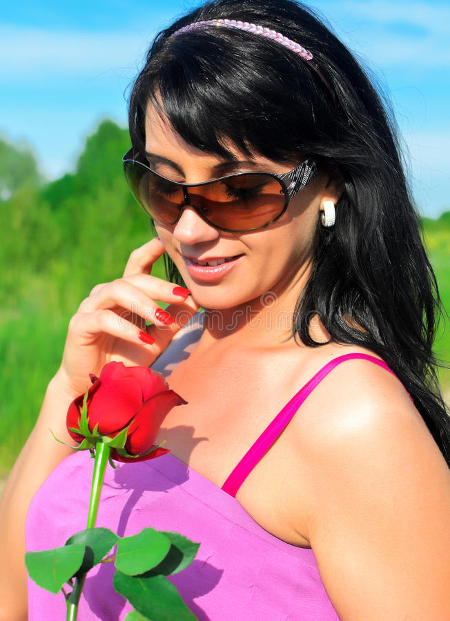 Woman Holding Red Rose Stock Image