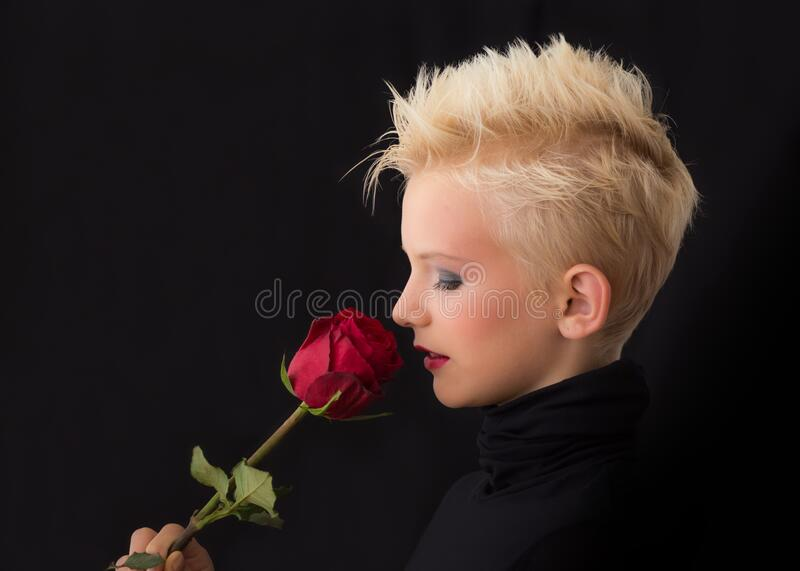 Woman Holding Red Rose royalty free stock photography