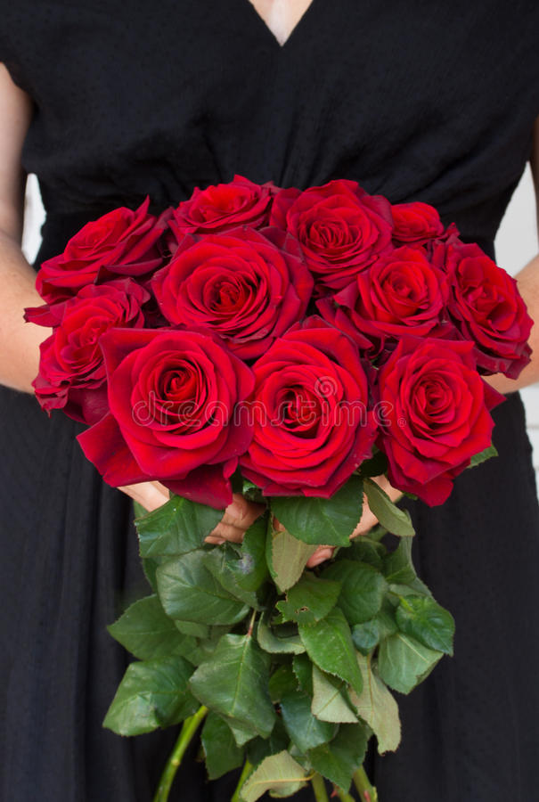 Woman holding red roses stock images