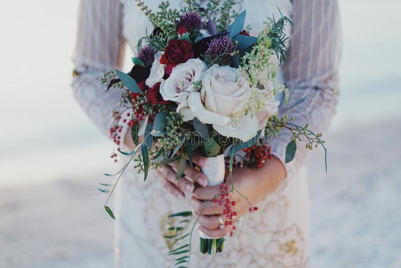 Woman Holding Red and White Rose Bouquet stock images