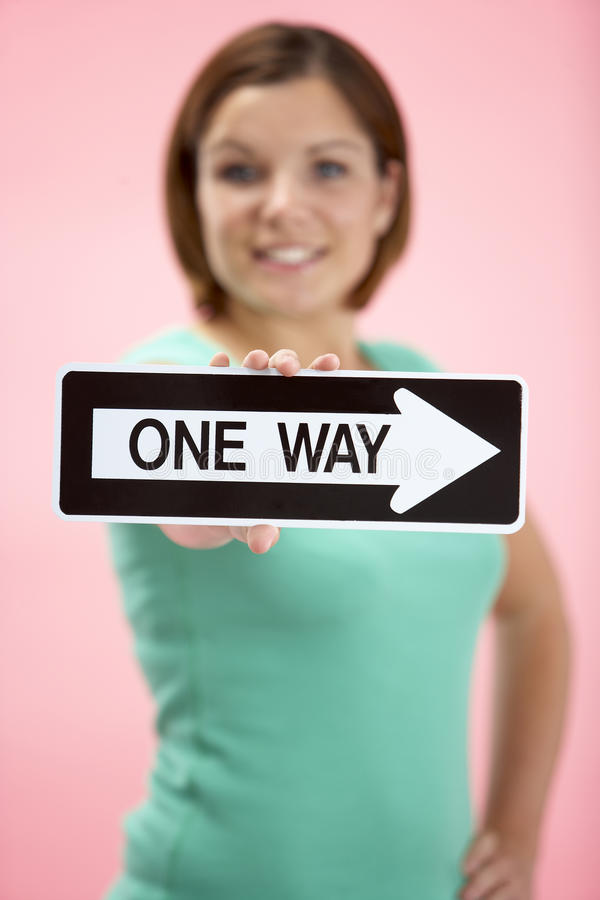 Download Woman Holding Road Traffic Sign Stock Photo - Image: 10001174