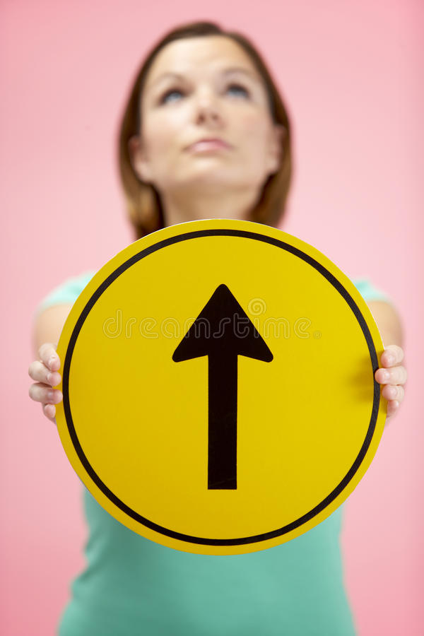 Download Woman Holding Road Traffic Sign Stock Image - Image: 10001185