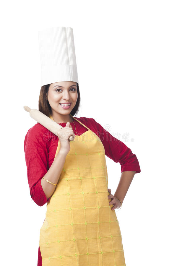 Woman holding rolling pin stock image