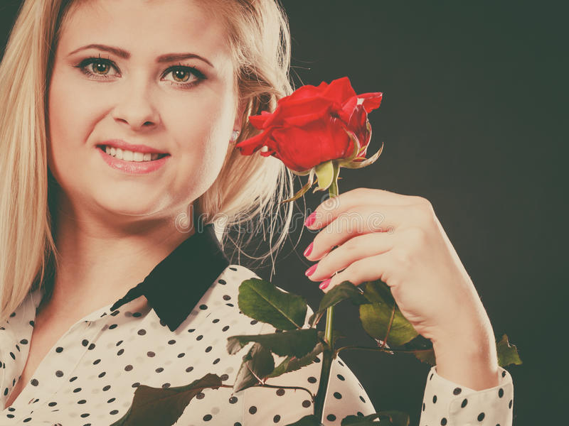 Woman holding rose flower on black stock images