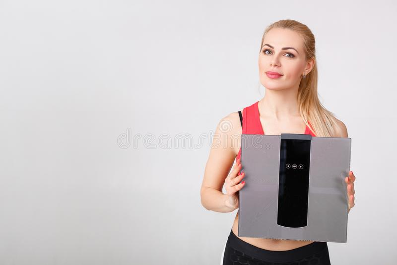 Woman holding scales in hands stock images