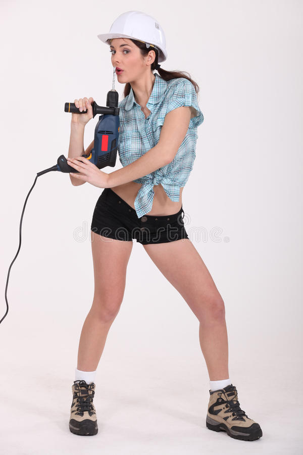 Woman holding a screwdriver stock photography