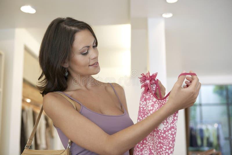 Woman Holding Shirt