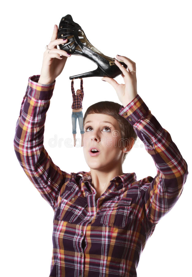 Woman holding a shoe stock photos