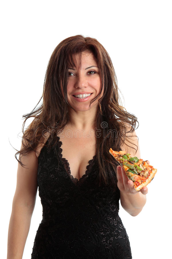 Woman holding a slice of pizza royalty free stock images