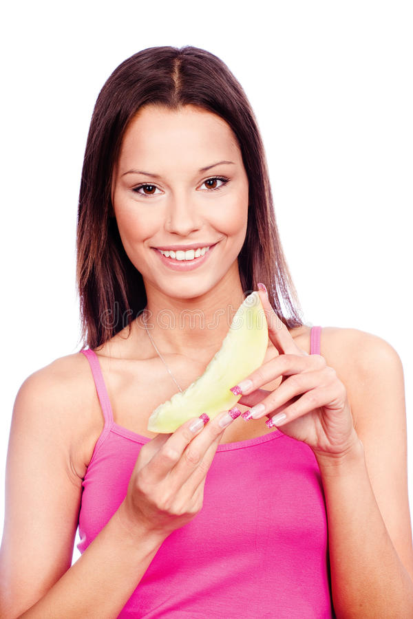Download Woman Holding Slice Of Yellow Melon Stock Photo - Image: 22935036
