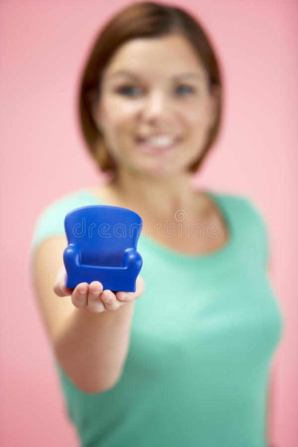 Woman Holding Small Armchair royalty free stock photos