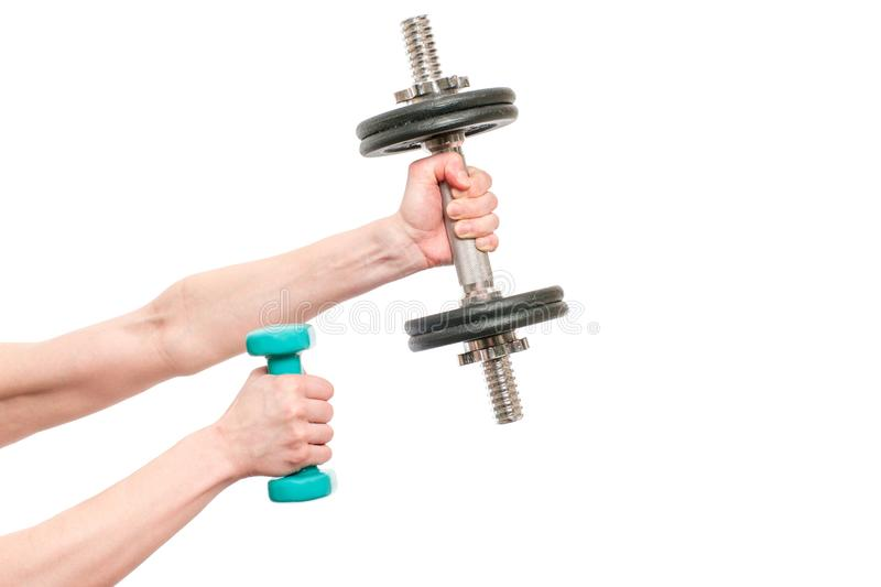 Woman holding small green and big black metal Dumbbell isolated on white background.  royalty free stock photography