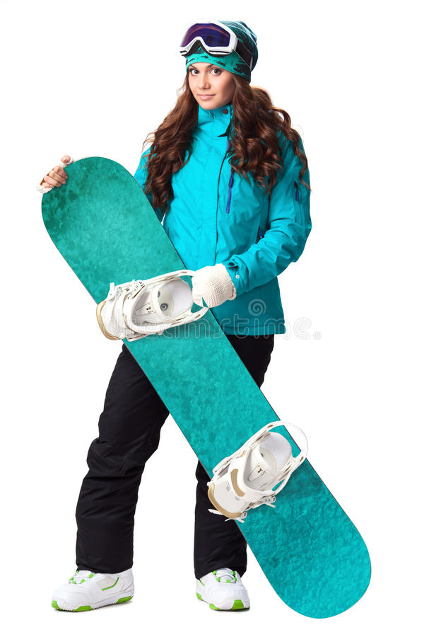 Woman holding snowboard in studio. Model wearing snoboard suit holding a snowboard in studio stock photography