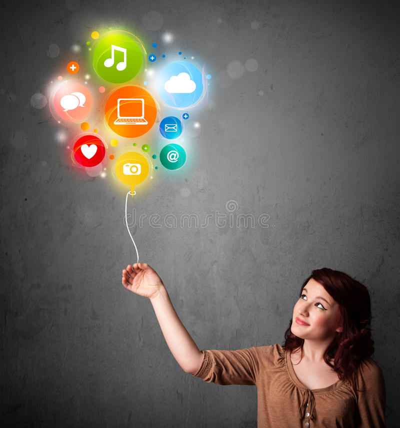 Woman holding social media balloon royalty free stock photography