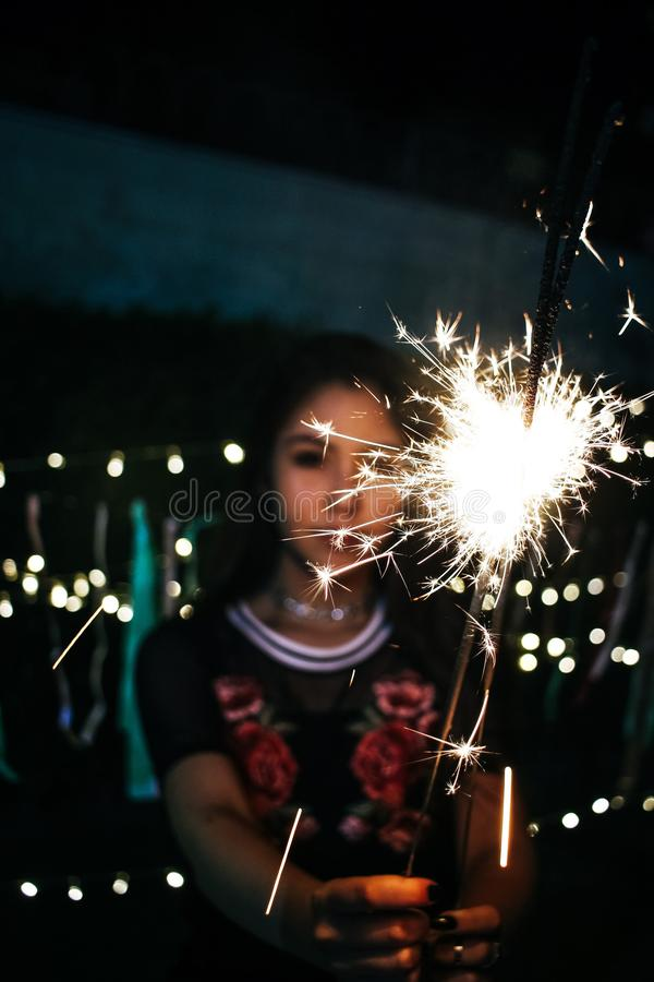 Woman Holding Sparkle during Nighttime stock photo