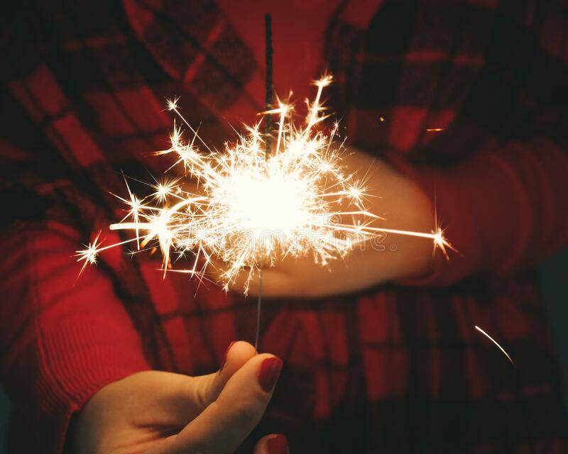 Woman holding sparkler stock photography