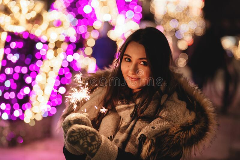 Woman holding sparkler royalty free stock images