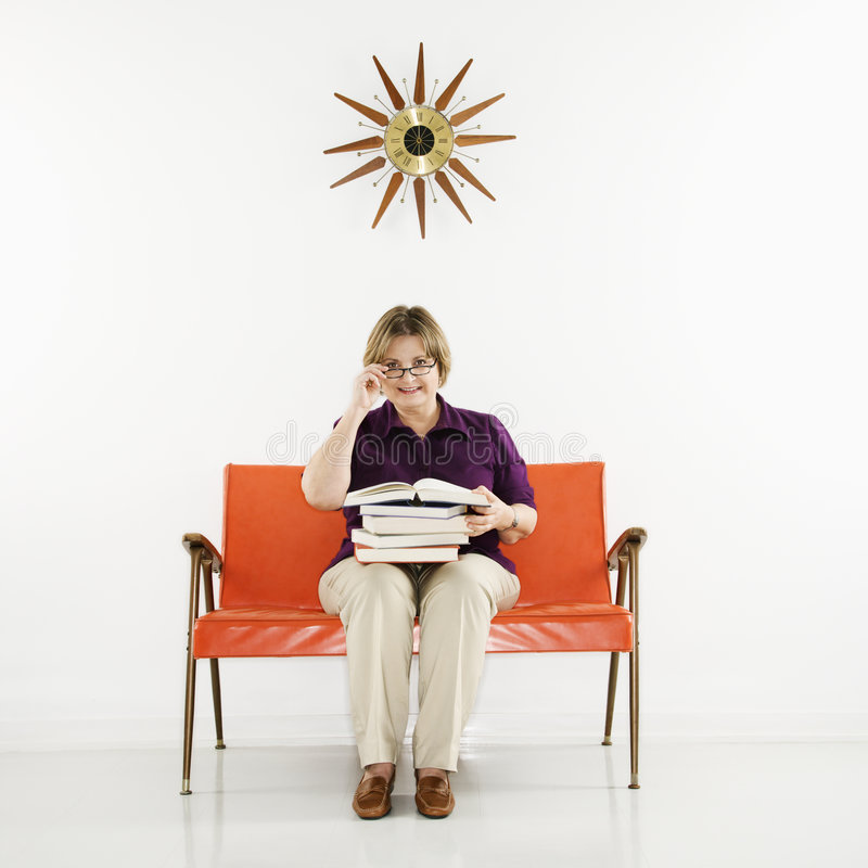 Download Woman Holding Stack Of Books. Stock Image - Image: 2425367