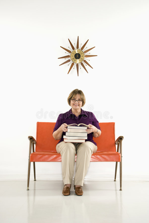 Woman Holding Stack Of Books. Stock Photo