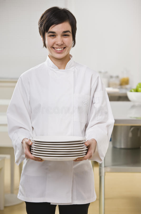 Download Woman Holding Stack Of Dishes Stock Photo - Image: 10321078