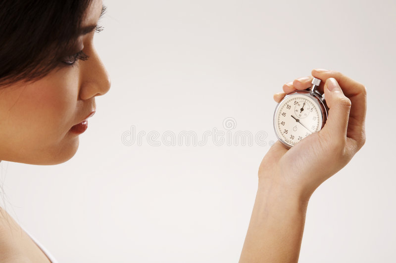 Woman Holding Stop Watch Royalty Free Stock Photo