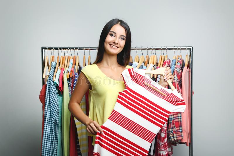 Woman holding striped dress royalty free stock photos