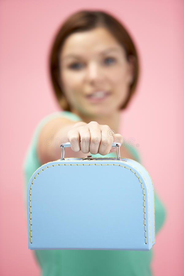 Woman Holding Suitcase royalty free stock image
