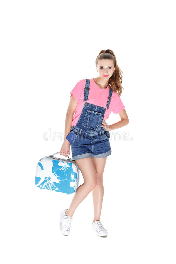 Woman holding suitcase and a passport. Beautiful young woman going on a journey. girl holding a blue travel suitcase and a passport. isolated on white background stock image