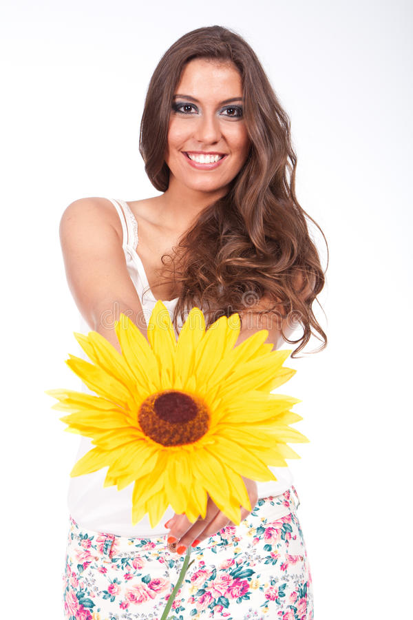 Woman holding a sunflower royalty free stock photos