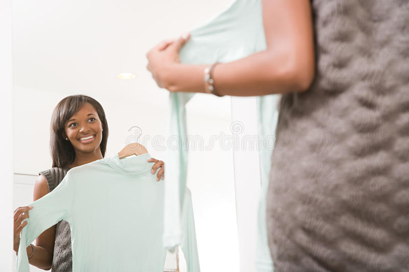 Woman holding a sweater stock image